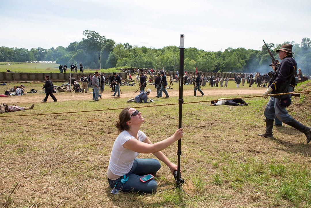 Emily Pelland, of Morgan State University, uses the Ricoh Theta camera to create a spherical image of the Battle of Selma reenactment on April 26, 2015 in Selma, Al to be included in a VR story about Selma, Al. The still images are rendered onto the connected smartphone shortly after the image is captured through the camera's Wi-Fi.