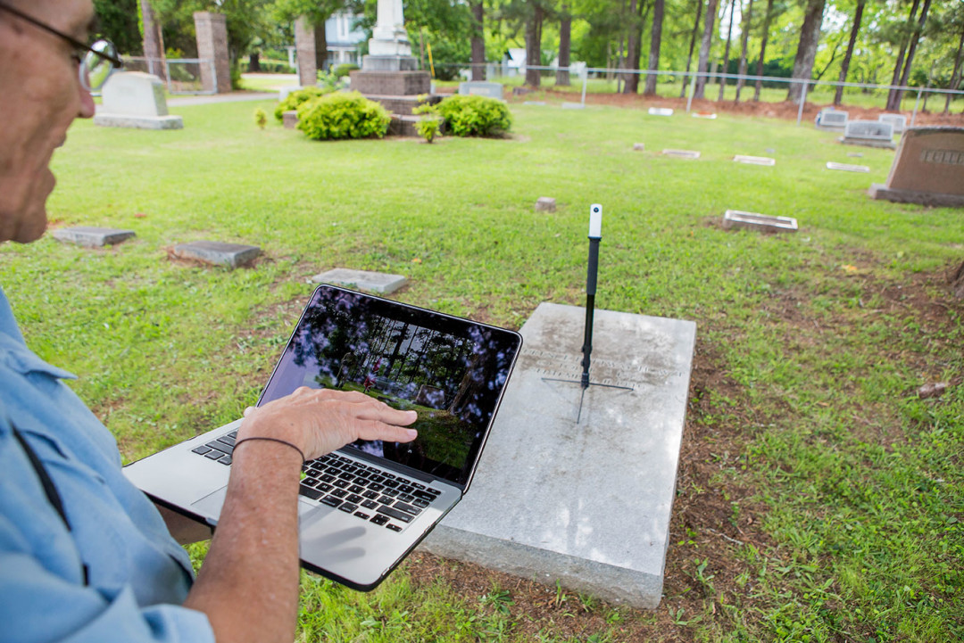Dr. Joel Beeson, of West Virginia University, uses the Ricoh Theta camera to create a spherical image Marion Cemetery in Marion, Al.